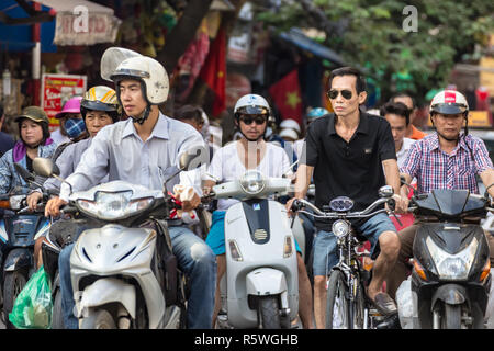 Hanoi, Vietnam - CIRCA October 2015:  it is estimated there are around 5 million scooters and motor bikes in Hanoi. Pollution becomes real problem. - Stock Photo
