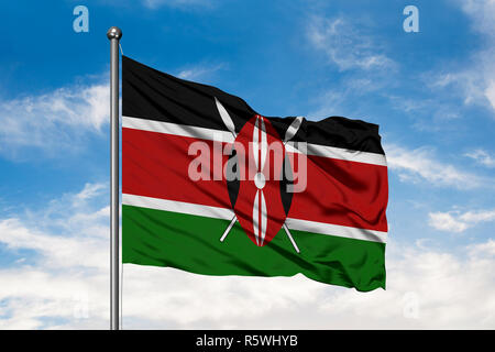 Flag of Kenya waving in the wind against white cloudy blue sky. Kenyan flag. - Stock Photo