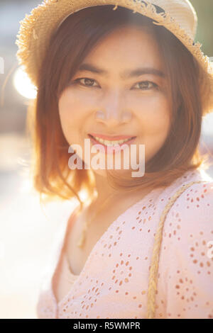close up face of beautiful asian woman toothy smiling face with happiness emotion - Stock Photo