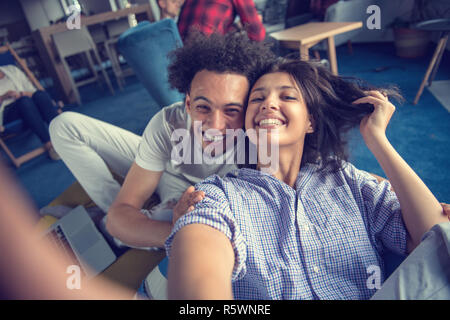 Group of happy smiling businesspeople making selfie and gesturing. - Stock Photo
