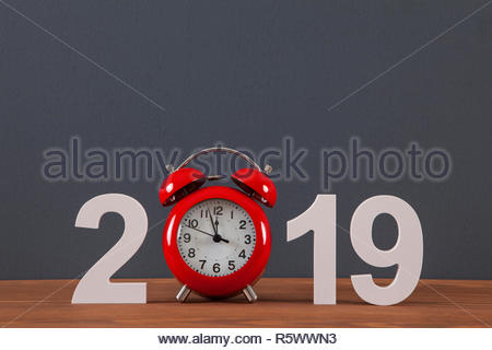 New year concepts countdown clock with red clock - Stock Photo
