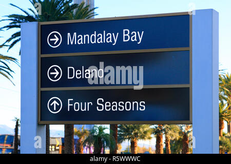 Street sign poiting to the Mandalay Bay, Delano and Four Seasons hotels on the strip in Las Vegas, Nevada - Stock Photo