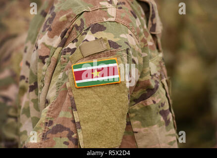 Flag of Suriname on soldiers arm (collage). - Stock Photo