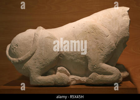 Ox or bull sitting. Sculpture from Santaella (Cordoba). Iberian Culture, 5th-4th cent. BC. Limestone. Archaelogical Museum of Catalonia. - Stock Photo