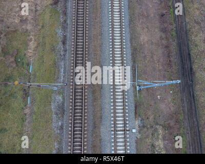 Plot railway. Top view on the rails. High-voltage power lines for electric trains - Stock Photo