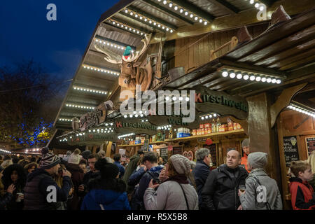 02 December 2018, Manchester Christmas Market, People enjoying the atmosphere in front of the Zum Lustigen Rudolph bar. - Stock Photo