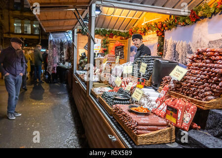 02 December 2018, Manchester Christmas Market. Stall selling continental.german salamis and sausages, - Stock Photo