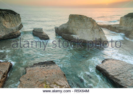 Sunset over Shark Fin Cove (Shark Tooth Beach). - Stock Photo