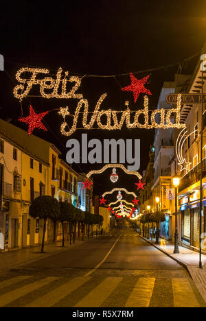 Merry Christmas Feliz Navidad Inscription And Christmas Decorations On The Street In Center Of Ronda City Malaga Province Andalusia Spain Stock Photo Alamy