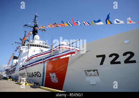 U.S. Coast Guard Cutter Morgenthau (WHEC 722) in full dress at the decommissioning ceremony in Honolulu, April 18, 2017. Morgenthau was commissioned in 1969 and has been home to more than 4,000 crewmembers during its 48 years of service. - Stock Photo