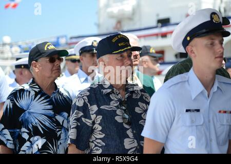 Crewmembers who previously served aboard U.S. Coast Guard Cutter Morgenthau (WHEC 722) were invited to fall into formation with the current crew during the decommissioning ceremony in Honolulu, April, 18, 2017. The decommissioning ceremony is a time-honored naval tradition that retires a ship from service through a variety of ceremonial observances. - Stock Photo