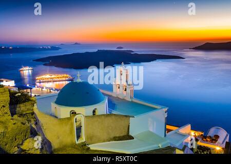 Firostefani, Santorini, Greece. Twilight with old greek church and caldera at Aegean Sea - Stock Photo