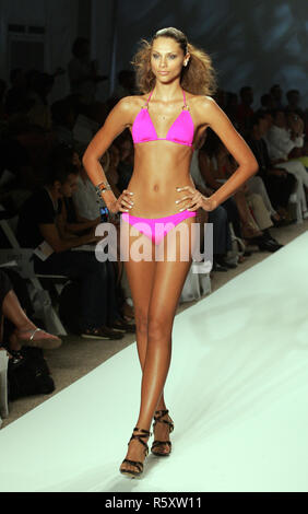 A model walks the runway during the Vitamin A Swimwear show at the Mercedes-Benz Fashion Week Swim, at the Raleigh Hotel in Miami Beach on July 19, 2009. - Stock Photo