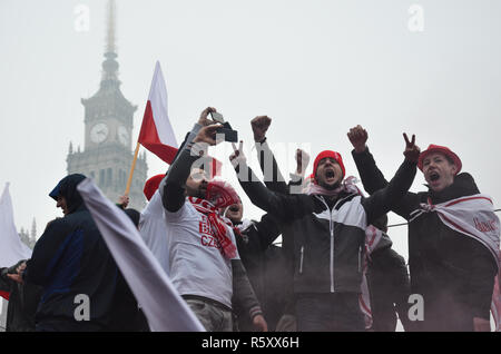 A group of men chanting on top of a bus stop, Polish National Independence Day march, 100 year anniversary, Warsaw, 11 November, Poland, 2018 - Stock Photo