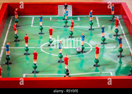 Player figurines of tabletop football game - Stock Photo