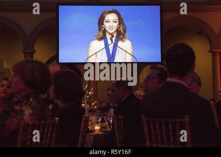 Jaclyn Mariano, surviving daughter of Air Force Master Sgt. Jude C. Mariano, delivers remarks after receiving the Senator Ted Stevens Leadership Award during the Tragedy Assistance Program for Survivors (TAPS) 2017 Honor Guard Gala in Washington, D.C., April 12, 2017. The leadership award recognizes an individual who has taken their experience and demonstrated outstandig leadership on behalf of other military survivors. During the event, the National Basketball Association and USA Basketball were awarded the inaugural National Community Partnership Award, presented for the support they have sh - Stock Photo