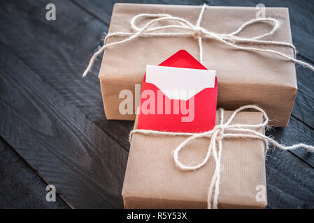 Presents and envelope with blank paper - Stock Photo