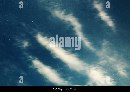 Night sky backgrounds with stars and clouds - Stock Photo