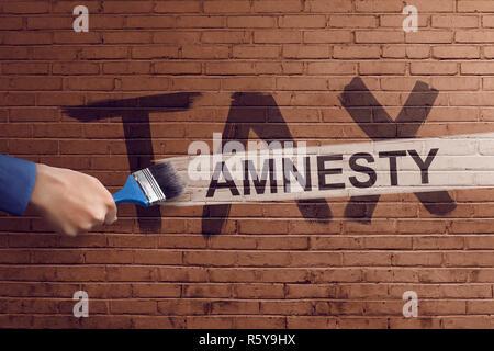 The hand writing tax amnesty - Stock Photo