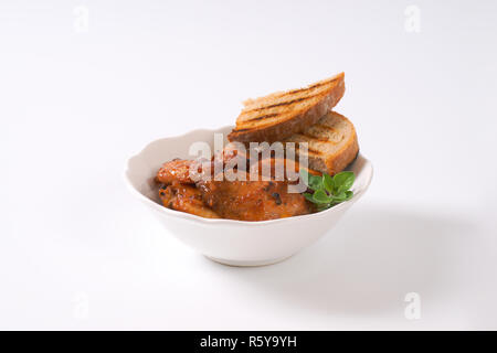 spicy Thai chicken wings with bread - Stock Photo