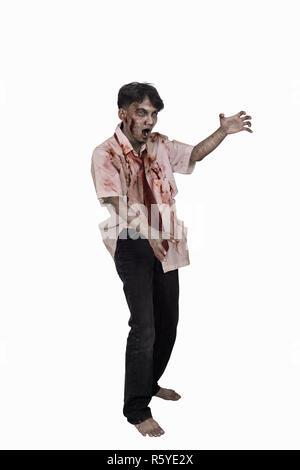 Portrait of horrible asian zombie man posing - Stock Photo