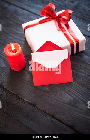 Stylish present and empty red letter - Stock Photo