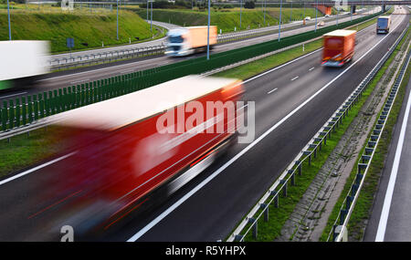Trucks on four lane controlled-access highway in Poland - Stock Photo