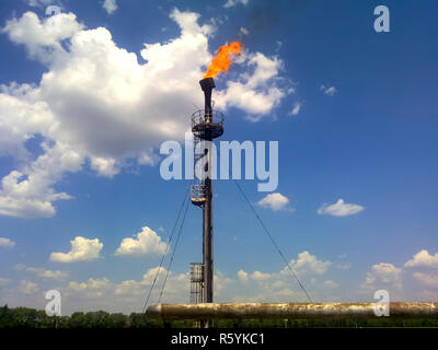 Flare for flaring associated gas. The end point of the pressure - Stock Photo