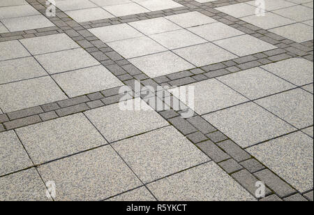 Figure out the paving slabs in the square. Background of paving - Stock Photo