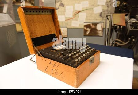 On 18 April 2017, the National Museum of the United States Navy welcomed the arrival of a four-rotor Enigma machine from the Cryptologic Command Display in Pensacola, FL. Acquired by the NMUSN, the Enigma is on loan to be featured at the museum in 2018 during the commemoration of the 75th anniversary of World War II. German Naval traffic began transmitting on 1 February 1943 over a four-rotor Enigma. NMUSN currently has on display a three-rotor Enigma, the type used prior to February 1942 for German Naval message encryption. While the specific machine being lent is one which was used for commu - Stock Photo