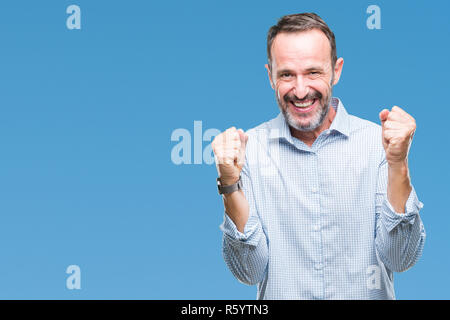 Middle age hoary senior business man over isolated background celebrating surprised and amazed for success with arms raised and open eyes. Winner conc