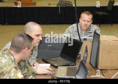 Maj. Joshua Montgomery, with the 177th Information Aggressor Squadron Air Force Base at McConnell Air Force Base, Kansas, prepares to engage in Cyber Shield 17 as a member of the red cell opposition force at Camp Williams, Utah, April 26, 2017. Cyber Shield 17 is a National Guard exercise designed to assess soldiers, airmen, and civilian personnel on-response plans to cyber incidents that is taking place April 24 to May 5, 2017 at Camp Williams, Utah. - Stock Photo