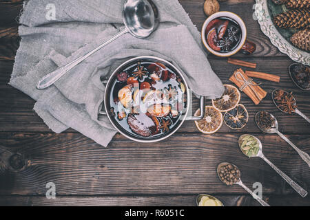 Ingredients in iron spoons for preparation of mulled wine - Stock Photo