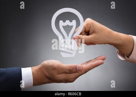 Close-up Of Businessperson Giving Idea - Stock Photo