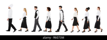 Young Restaurant Staff Walking In Row - Stock Photo