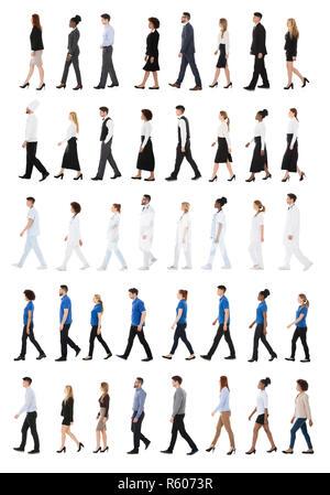 Multiracial Businesspeople Walking In Row - Stock Photo
