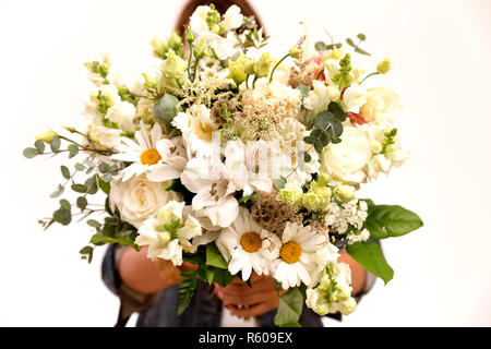 Big floral bouquet in woman's hands - Stock Photo