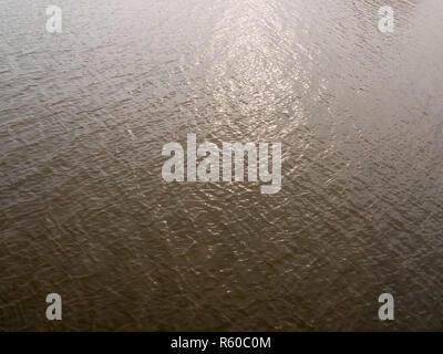 grey light streaked reflecting sea surface water background - Stock Photo