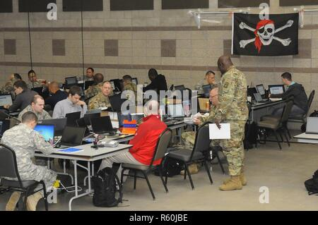 Members of the Army National Guard, Air National Guard and Army Reserve, and civilians working in information technology prepare to engage as opposition force, or 'red cell' in Cyber Shield 17 at Camp Williams, Utah, April 26, 2017. Cyber Shield 17 is a National Guard exercise designed to assess soldiers, airmen, and civilian personnel on-response plans to cyber incidents that is taking place April 24 to May 5, 2017 at Camp Williams, Utah. - Stock Photo