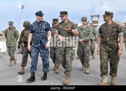 NAVAL STATION ROTA, Spain (April 25, 2017) – U.S. Marine Maj. Curtis Shreve, commanding officer, Fleet Antiterrorism Security Team Company Europe, discusses pier security operations with Vice Adm. Christopher Grady, commander, U.S. 6th Fleet, during his visit to Naval Station (NAVSTA) Rota, Spain, April 25, 2017. During Grady's first visit to NAVSTA Rota since he assumed command of U.S. 6th Fleet, he participated in a Commander, Task Force 68 capabilities exhibition, met with Spanish Navy leadership and visited USS Porter (DDG 78) to speak with their leadership and crew. U.S. 6th Fleet, headqu - Stock Photo