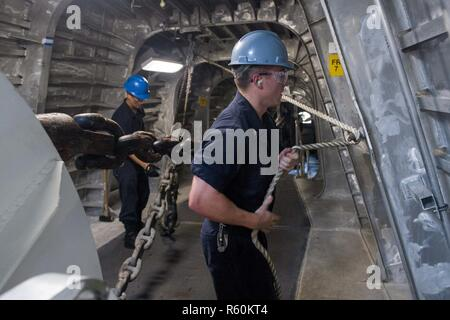 CHANGI NAVAL BASE, Singapore (April 27, 2017) Sailors ready the anchor chain during a fast cruise aboard littoral combat ship USS Coronado (LCS 4). Coronado is on a rotational deployment in U.S. 7th Fleet area of responsibility, patrolling the region's littorals and working hull-to-hull with partner navies to provide 7th Fleet with the flexible capabilities it needs now and in the future. - Stock Photo
