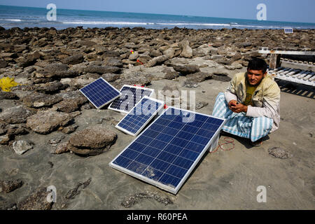 Solar panels lie under the sun on the sea beach at Saint Martin Island. Cox's Bazar, Bangladesh. - Stock Photo