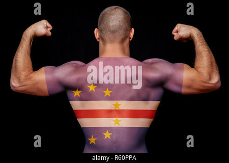 The back of a young sports man wearing a T-shirt with the national flag of Cape Verde on a black isolated background. The concept of national pride an - Stock Photo