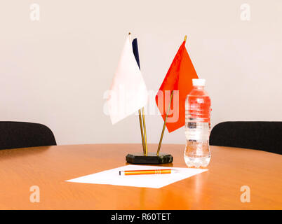 The table with small three flags. The mock up or blank flag on white, red, blue background - Stock Photo