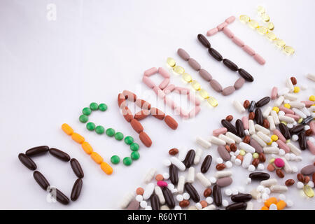 Conceptual Hand writing text caption inspiration Medical care Health concept written with pills drugs capsule word disability On white isolated background with copy space - Stock Photo