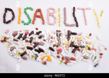 Conceptual Hand writing text caption inspiration Medical care Health concept written with pills drugs capsule word disability On white isolated background with copy space