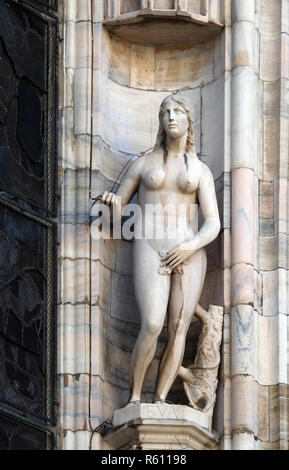 Eve, statue on the Milan Cathedral, Duomo di Santa Maria Nascente, Milan, Lombardy, Italy - Stock Photo