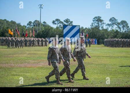 Maj. Gen. Leopoldo Quintas, left, incoming Commander of 3rd Infantry Division, Gen. Robert Abrams, center, Commander U.S. Forces Command, and Maj. Gen. James Rainey, right, outgoing Commanding General 3rd Infantry Division, complete the inspection of troops. The 3rd Infantry Division change of command ceremony was held on Cotrell Field at Fort Stewart, GA, May 8, 2017. - Stock Photo