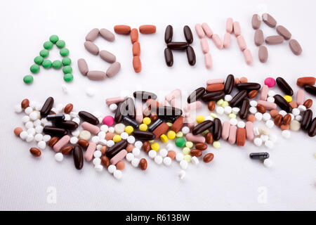 Hand writing text caption inspiration Medical care Health concept written with pills drugs capsule word asthma On white isolated background with copy space - Stock Photo