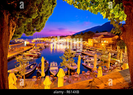 Town of Bol on Brac island harbor at sunset view - Stock Photo